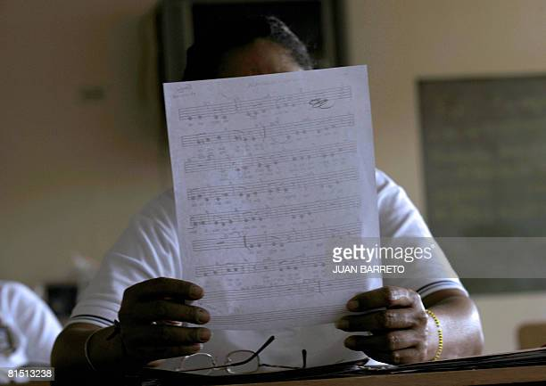 An inmate of the women's prison Instituto Nacional de Orientacion Femenina attends singing lessons on June 10 2008 inside the prison in the locality...
