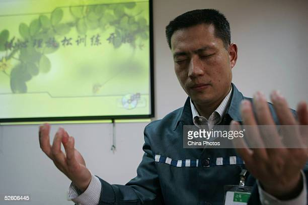 An Inmate receives a psychological correctional treatment during a psychological training and consultation session at Qingpu Prison on April 8 2005...