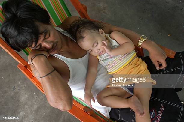 An inmate rests with his daughter He is a gang member from BCJ The BCJ is one of 4 major gangs in Manila City Jail Manila City Jail was built for 800...
