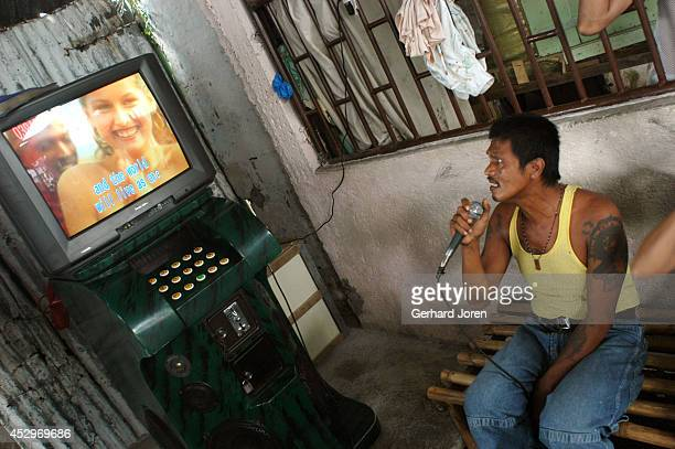 An inmate sings karaoke at Sputnik gang, one of 4 major gangs in Manila City Jail. Manila City Jail was built for 800 prisoners by the Spanish in the...