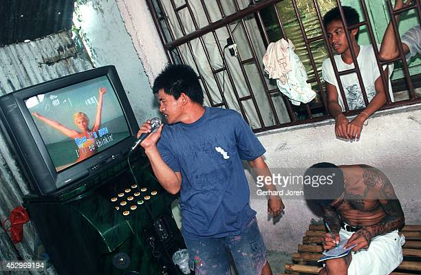 An inmate sings karaoke at the dorm of Sputnik gang, one of the four major gangs in Manila City Jail. Manila City Jail was built for 800 prisoners by...