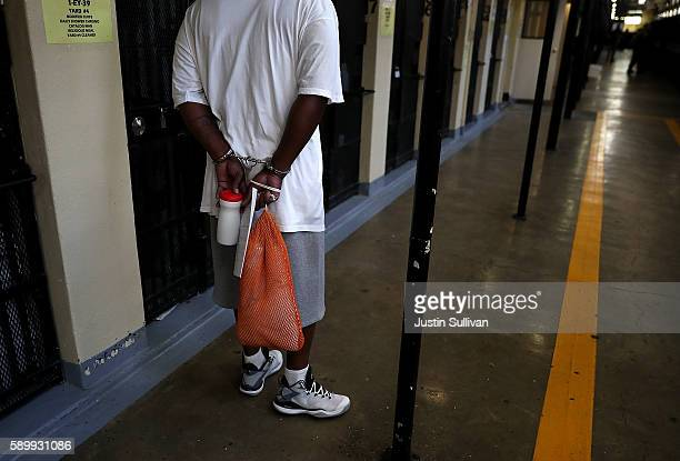 An inmate stands with handcuffs on at San Quentin State Prison's death row on August 15 2016 in San Quentin California San Quentin State Prison...