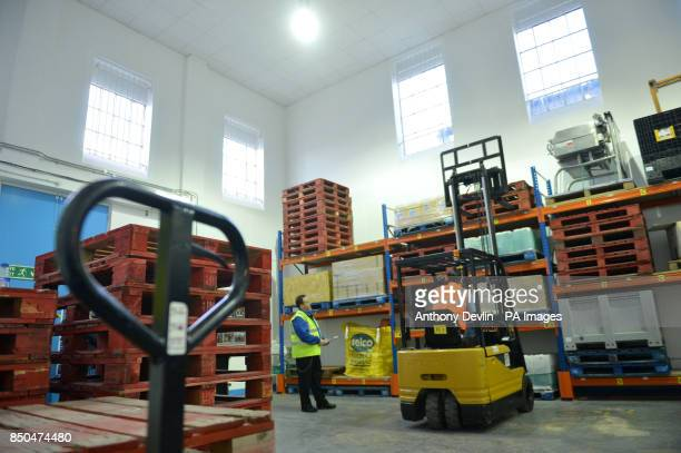 An inmate takes a forklift truck driving test inside Pentonville Prison London