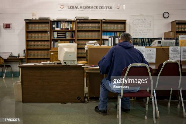 An inmate uses a typewriter in the library of the North Central Correctional Institution in Marion Ohio US on Wednesday June 15 2011 As Ohio tries to...