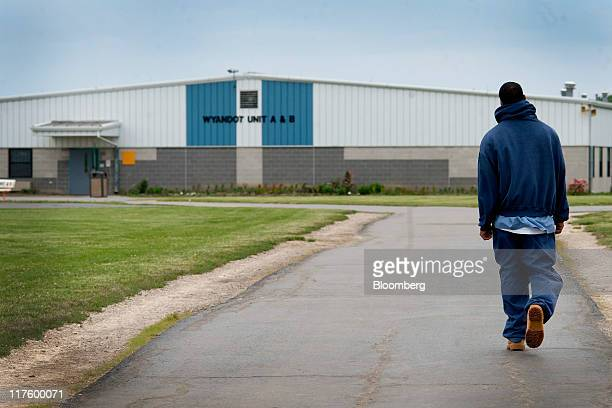 An inmate walks through the yard at the North Central Correctional Institution in Marion Ohio US on Wednessday June 15 2011 As Ohio tries to close an...