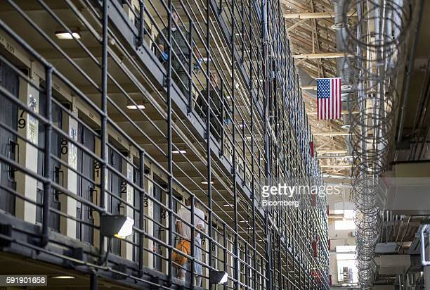 An inmate walks to his cell as corrections officers patrol at San Quentin State Prison in San Quentin California US on Tuesday Aug 16 2016 San...