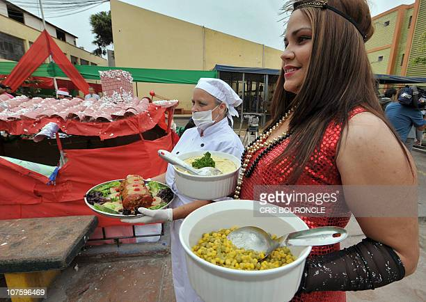 An inmate wears a US traditional attire as another one carries a traditional dish at Santa Monica female detention center in Lima during a Christmas...