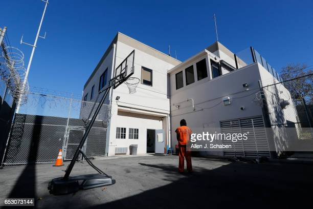An inmate who is serving four months for DUI and is serving his time in the paytostay program stands in the recreation yard at the Seal Beach...