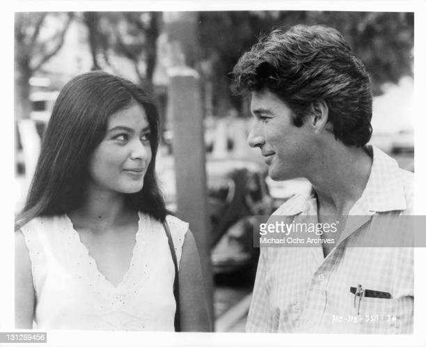 An innocent meeting in a pharmacy starts sparks flying between Elpidia Carrillo and Richard Gere in a scene from the film 'Beyond The Limit' 1983