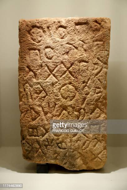 An inscribed stele dating from the sixth to eleventh century BC is displayed during the exhibition AlUla Wonder of Arabia at the l'Institut du monde...