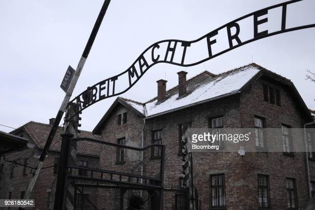 An inscription 'Arbeit Macht Frei' sits above the main gate at the AuscwitzBirkenau concentration camp museum in AuscwitzBirkenau Poland on Wednesday...