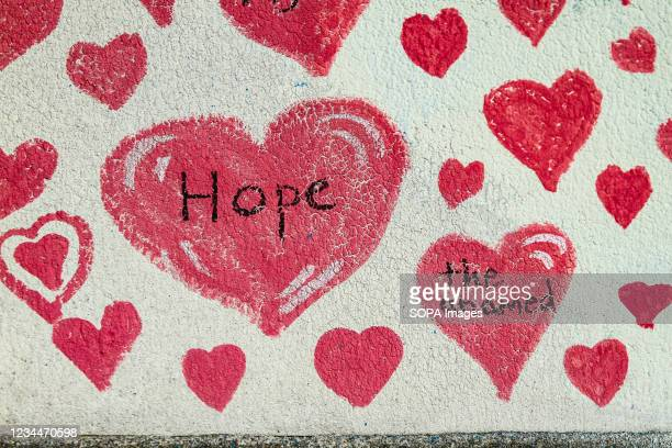 An inscription on a red heart on the Covid19 National Memorial Wall. The National Covid Memorial Wall runs for about a mile along the Thames river...