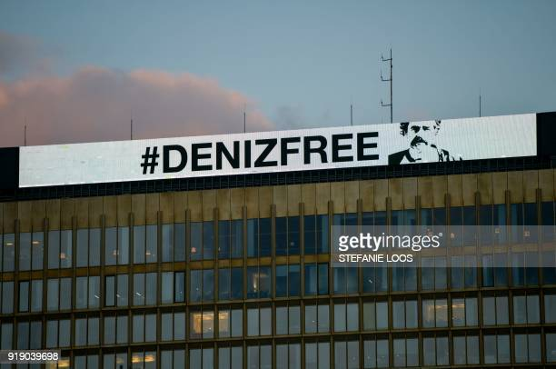 An inscription reading 'Denizfree' is seen on the top of the headquarters of German newspaper 'Die Welt' on February 16 2018 in Berlin after Turkey...