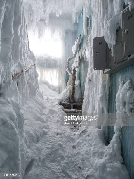 An inside view from snow and ice covered abandoned building in Severny region, 17 kilometers from coal-mining town Vorkuta, Komi Republic, Russia on...