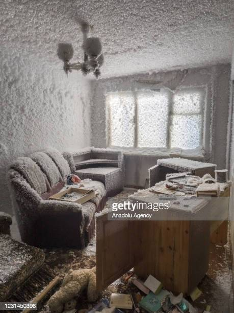 An inside view from snow and ice covered abandoned building in Sementnozavodsky region, 19 kilometers from coal-mining town Vorkuta, Komi Republic,...