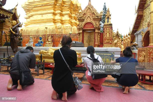 An inside view of people praying inside Wat Phrathat Doi Suthep temple near Chiang Mai On Wednesday June 13 in Wat Phrathat Doi Suthep Chiang Mai...