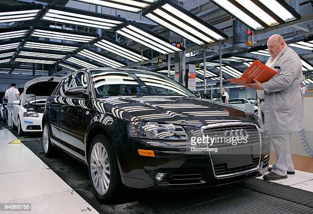 An inspector checks the papers for a new Audi automobile at the company's factory in Ingolstadt Germany on Tuesday April 1 2008 German business...