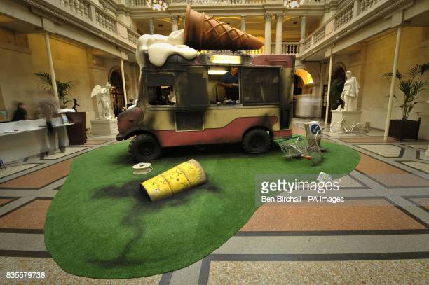 An installation art piece by Banksy showing a wrecked and grafitti'd ice cream van at Bristol Museum where the artist is exhibiting his work