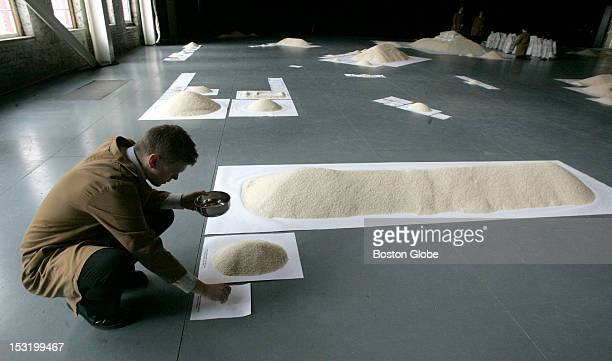 An installation at the Massachusetts Museum of Contemporary Art titled Of All the People in All the World uses rice to illustrate populations...