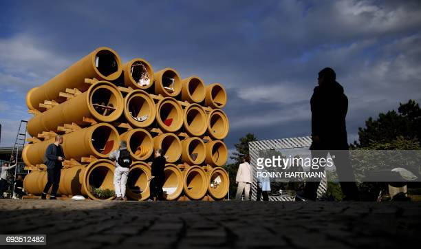 An installation by artist Hiwa K and the 'Rahmenbau' by artist group HausRuckerCo are pictured at the Documenta 14 art exhibition in Kassel on June 7...