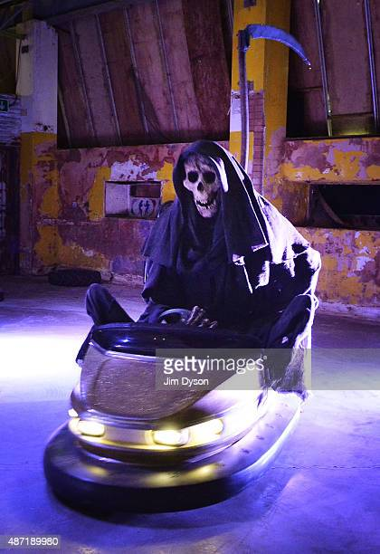 An installation by Banksy depicts the grim reaper riding on a dodgem car as Banksy's Dismaland Bemusement Park opens to the public on August 28 2015...