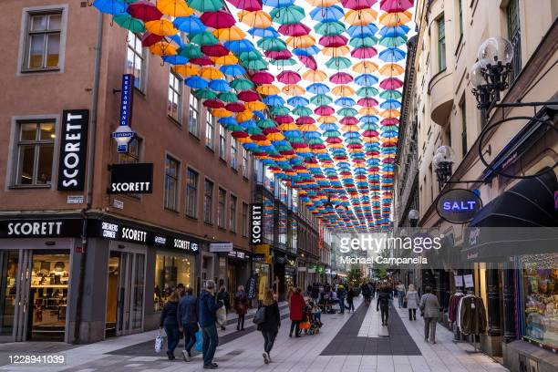 """An installation entitled """"Umbrella Sky Project"""" created by Portuguese artist Patricia Cunha and composed of suspended colorful umbrellas is seen on..."""