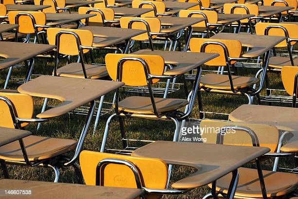 An installation of 857 empty school desks representing the number of students nationwide who are dropping out every hour of every school day is on...