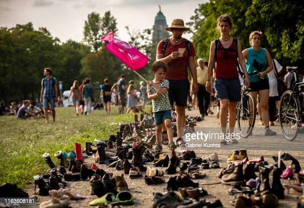 An installation of thousands of shoes to remember migrants who passed away in the Mediterranean at the Unteilbar march against racism exclusion and...
