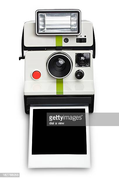 An instant camera with a flash developing film