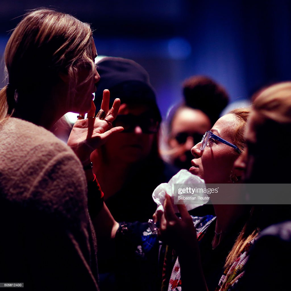 An instant view of a makeup artist in the backstage before the Minx by Eva Lutz show during the Mercedes-Benz Fashion Week Berlin Autumn/Winter 2016 at Brandenburg Gate on January 20, 2016 in Berlin, Germany.
