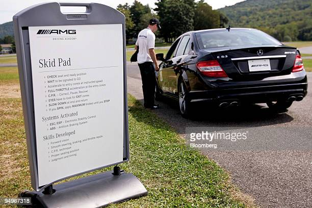 An instructor goes over the rules with a driver in a MercedesBenz C63 AMG during a MercedesBenz AMG Driving Academy event at the Lime Rock Park...