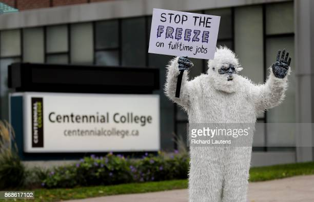 An instructor is dressed up as a Yeti while she walks the picket line at the East York Centennial College campus She is both keeping warm and...