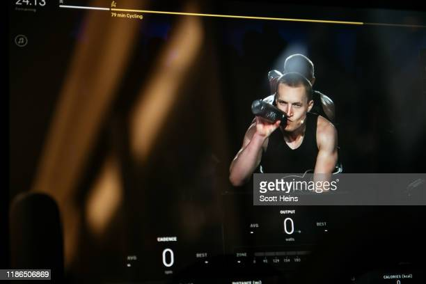 An instructor is seen on the video display of a Peloton stationary bike at the fitness company's studio on Manhattan's 23rd Street on December 4,...