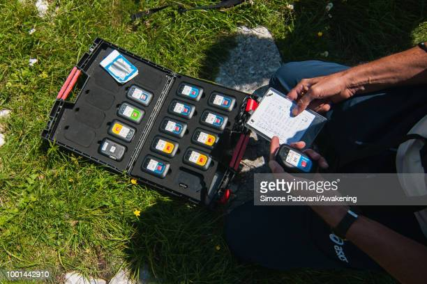 An instructor of the Aeroclub Feltre gives to the British paragliders the GPS devices to track them before the training at Monte Avena on July 18...