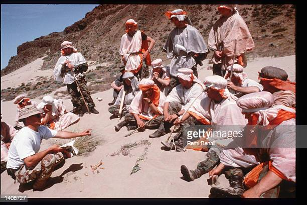 An instructor shows edible plants during desert survival training at the US Air Force Survival Training Center September 13 1995 in George Dunes WA...