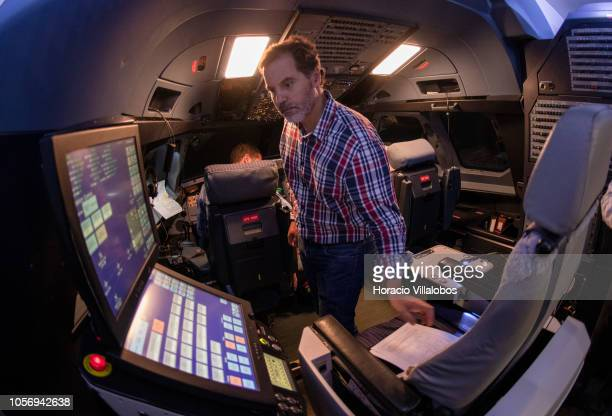An instructor takes his seat in from of the computer in TAP A320 medium range flight simulator before the start of a training session at TAP Air...