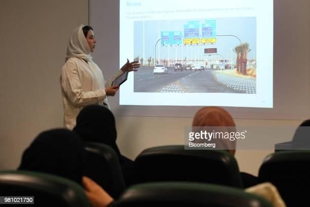 An instructor teaches women road craft and the highway code in a training room at the Saudi Aramco driving school for women at the headquarters of...
