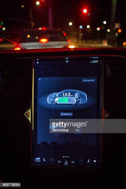 An instrument panel with Tesla Motors Inc 80 software displays 163 miles of charge range remaining inside a Model S P90D vehicle in the Brooklyn...
