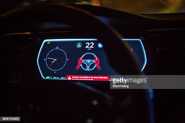 An instrument panel with the Tesla Motors Inc 80 software update displays a warning reading 'Autosteer Unavailable for the Rest of This Drive' inside...