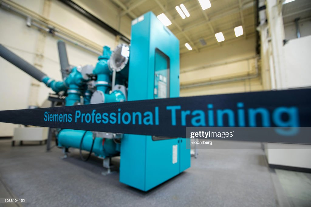 An insulated gas switchgear mechanism sits on display in the training center inside Siemens AG electronic power unit factory in Berlin, Germany, on Thursday, Sept. 13, 2018. Nearly one year afterSiemens unveiled a plan for massive jobs cuts at its struggling power and gas division, Chief Executive OfficerJoeKaesersaid talks with unions are nearing completion, clearing the way for a revamp of the business just as an industry slump deepens. Photographer: Krisztian Bocsi/Bloomberg via Getty Images