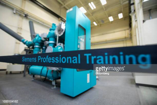An insulated gas switchgear mechanism sits on display in the training center inside Siemens AG electronic power unit factory in Berlin Germany on...
