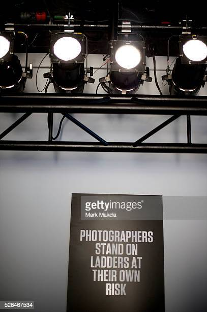 An insurance disclaimer warns photographers the day before London Fashion Week coomences at the BFC Showspace venue at Somerset House in London on 17...