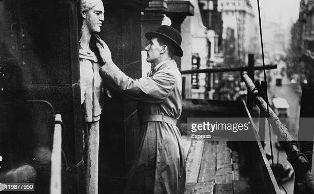 An insurance inspector examing one of the sculptures by Jacob Epstein on the second floor of the former British Medical Association headquarters at...