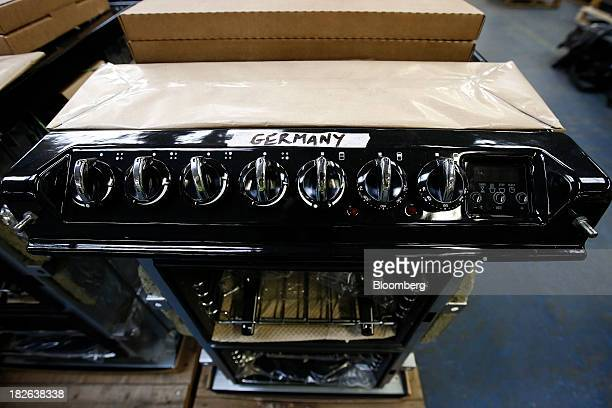 An integrated front module for an AGA range cooker produced by AGA Rangemaster Plc destined for Germany sits awaiting completion at the company's...