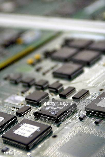 An Intel chip is seen in a circuit board being built at an ECI Telecom high-tech plant January 15, 2003 in Petah Tikva which is located in central...