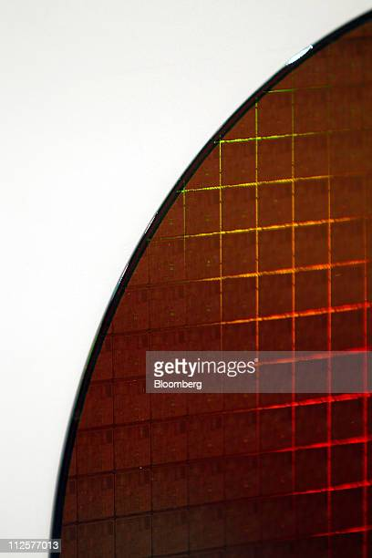 An Intel Corp Pentium 4 wafer is displayed at the company's museum in Santa Clara California US on Tuesday April 19 2011 Intel Corp the biggest...