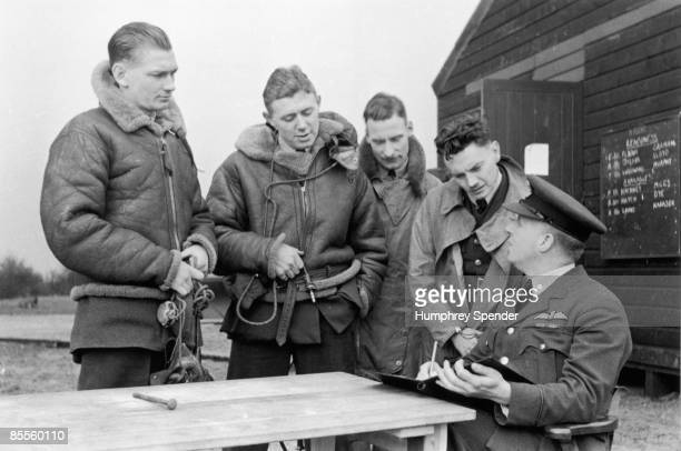 An Intelligence Officer receives reports from three British pilots and a Squadron Leader during World War II 1940 Original Publication Picture Post...