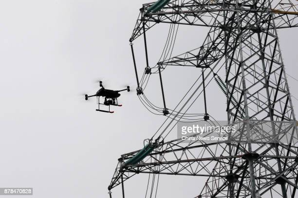 An intelligent drone patrols at a 500kilovolt converter station at Shapingba district on November 23 2017 in Chongqing China The State Grid Chongqing...