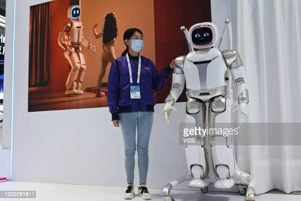 An intelligent humanoid service robot named 'Walker' is on display at the booth of UBTECH Robotics Inc. During China International Big Data Industry...