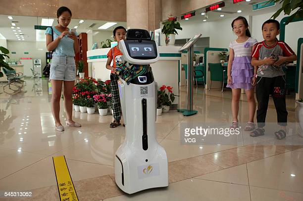 An intelligent robot walks at hall of Sichuan Neijiang Branch Agriculture Bank of China on July 7 2016 in Neijiang Sichuan Province of China An...
